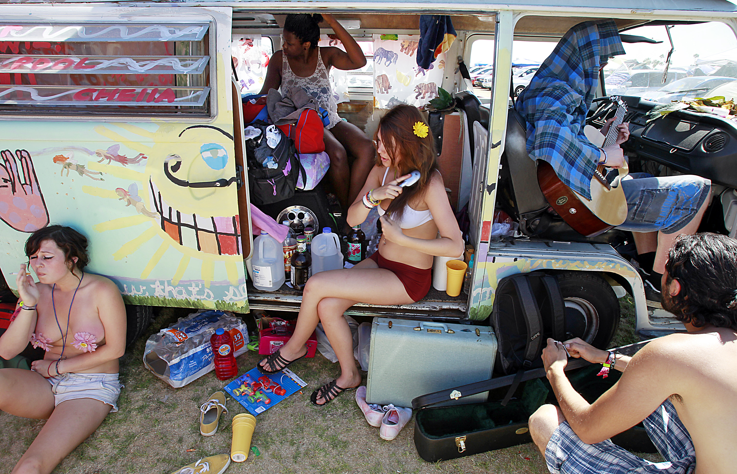 A group of festivalgoers chill out at an onsite campground Sunday, April 17, 2011, at the Coachella