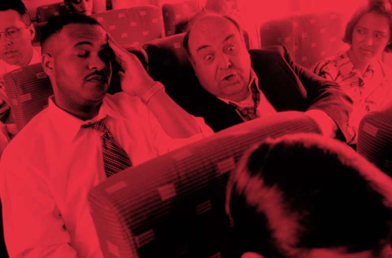 MAN ANNOYING AIRPLANE PASSENGER