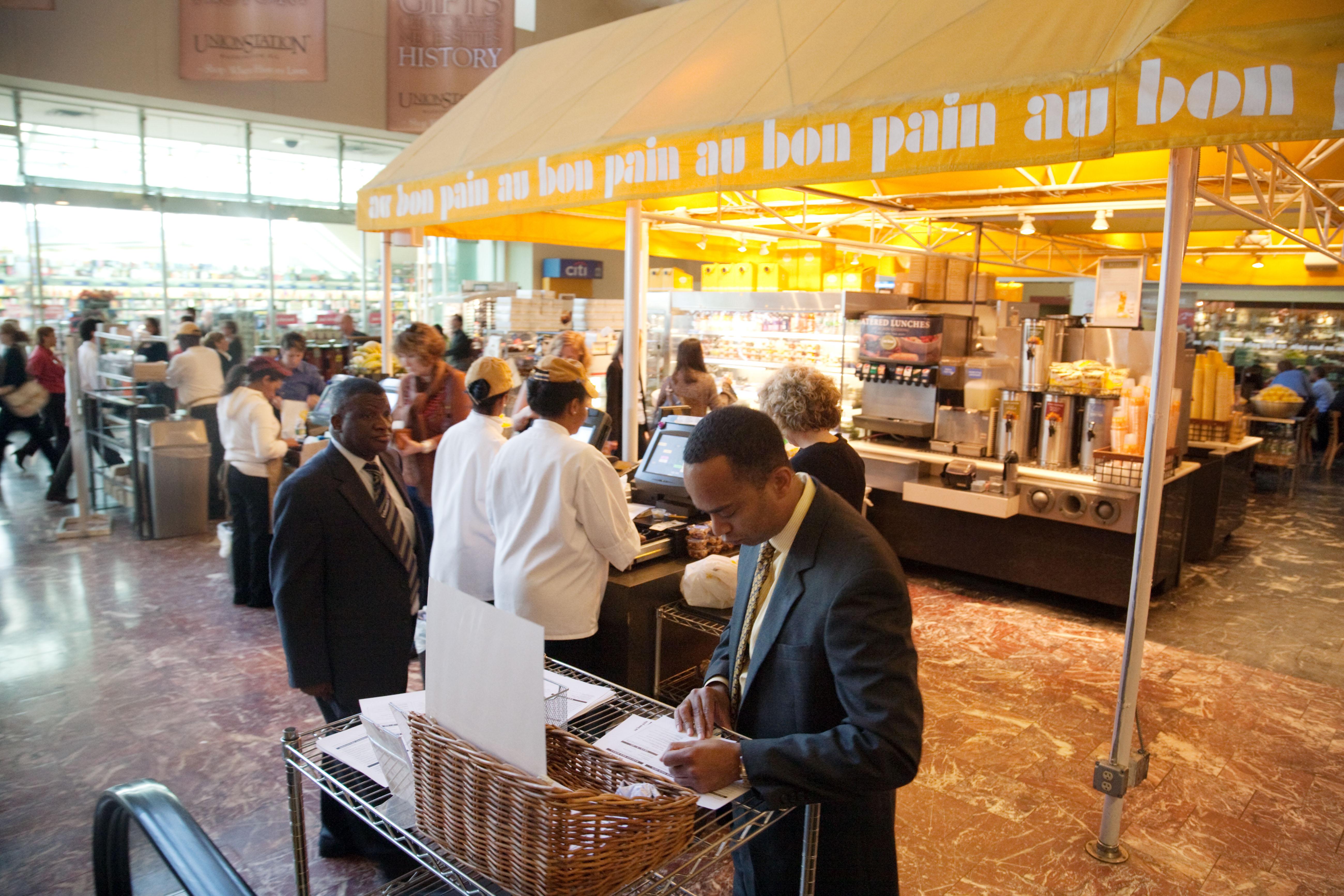 People buying food at Au Bon Pain restaurant / cafe , Union Station, Washington DC USA