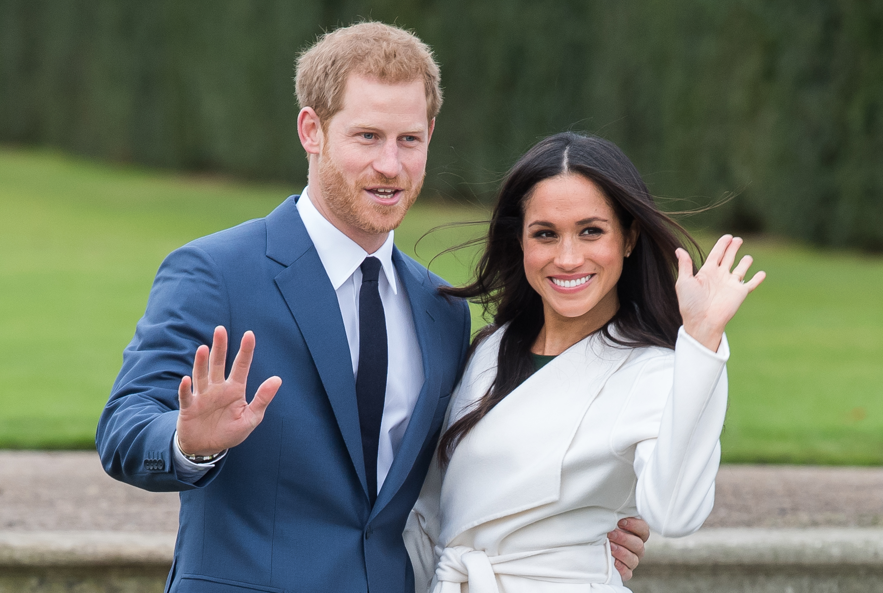 Prince Harry and Meghan Markle during an official photocall to announce the engagement of Prince Harry and actress Meghan Markle at The Sunken Gardens at Kensington Palace on November 27, 2017 in London, England.