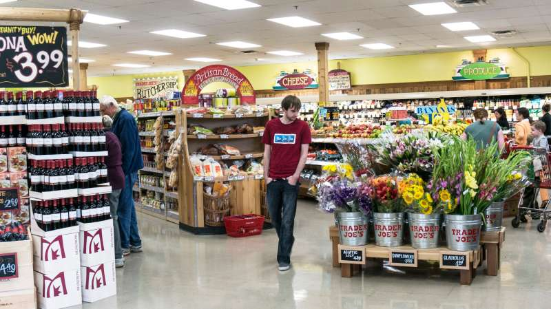 bright colorful spacious interior of Trader Joes market with displays  wine fruit artisan bread buckets fresh flowers Lynnwood