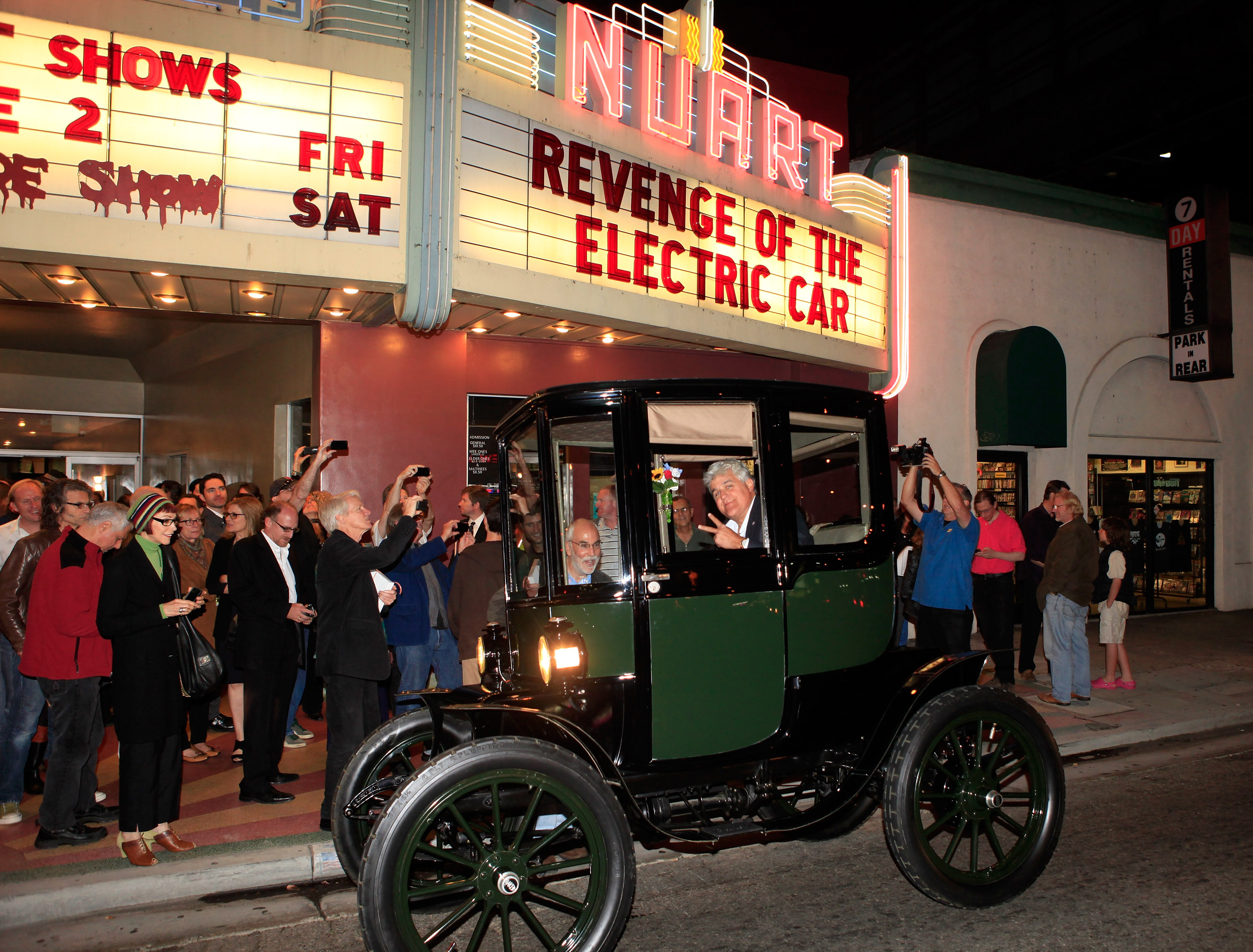 "Jay Leno arrives in his 1909 Baker Electric car at ""Revenge Of The Electric Car"" Premiere held at Landmark Nuart Theatre on October 21, 2011 in Los Angeles, California."