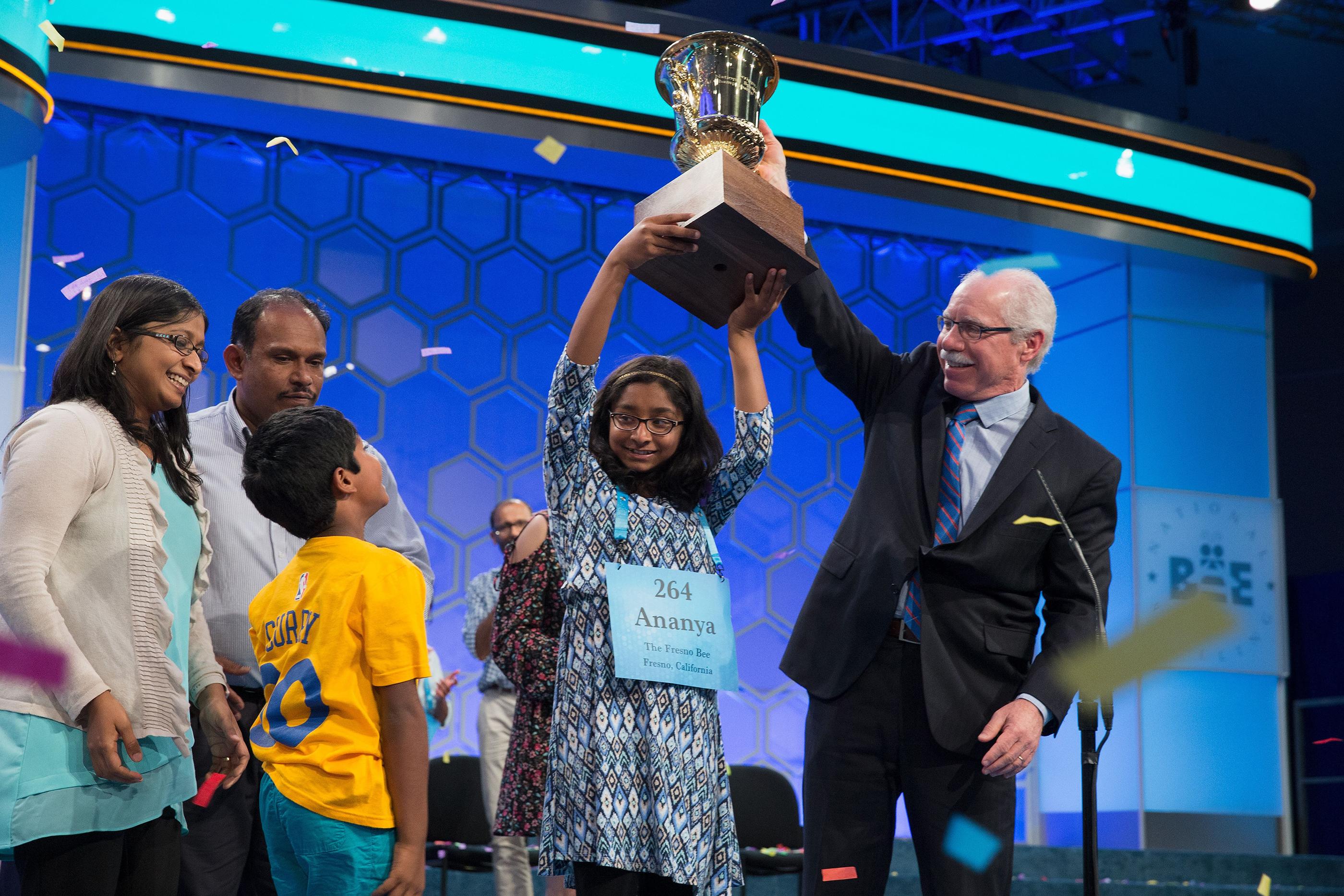 180529-raising-spelling-bee-champion-trophy