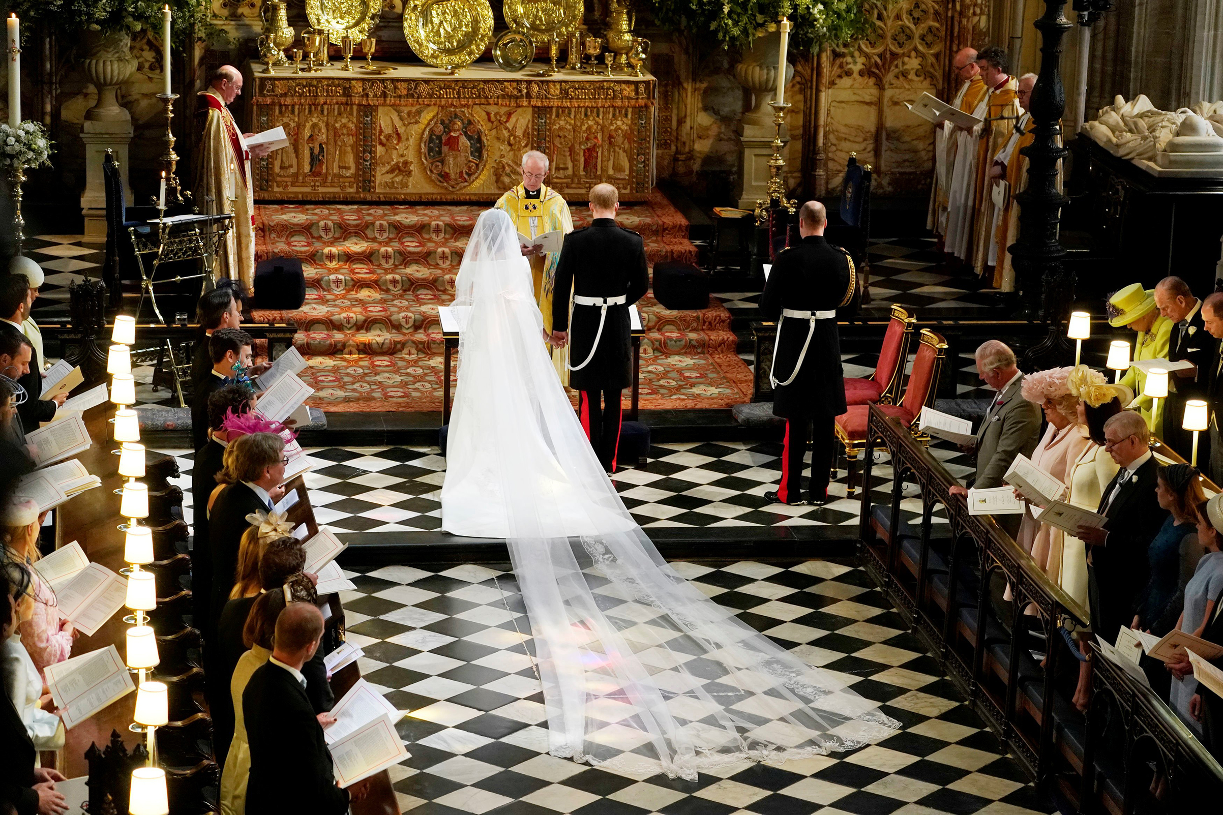 Prince Harry and Meghan Markle in St George's Chapel at Windsor Castle during their wedding service, conducted by the Archbishop of Canterbury Justin Welby in Windsor, Britain, May 19, 2018.