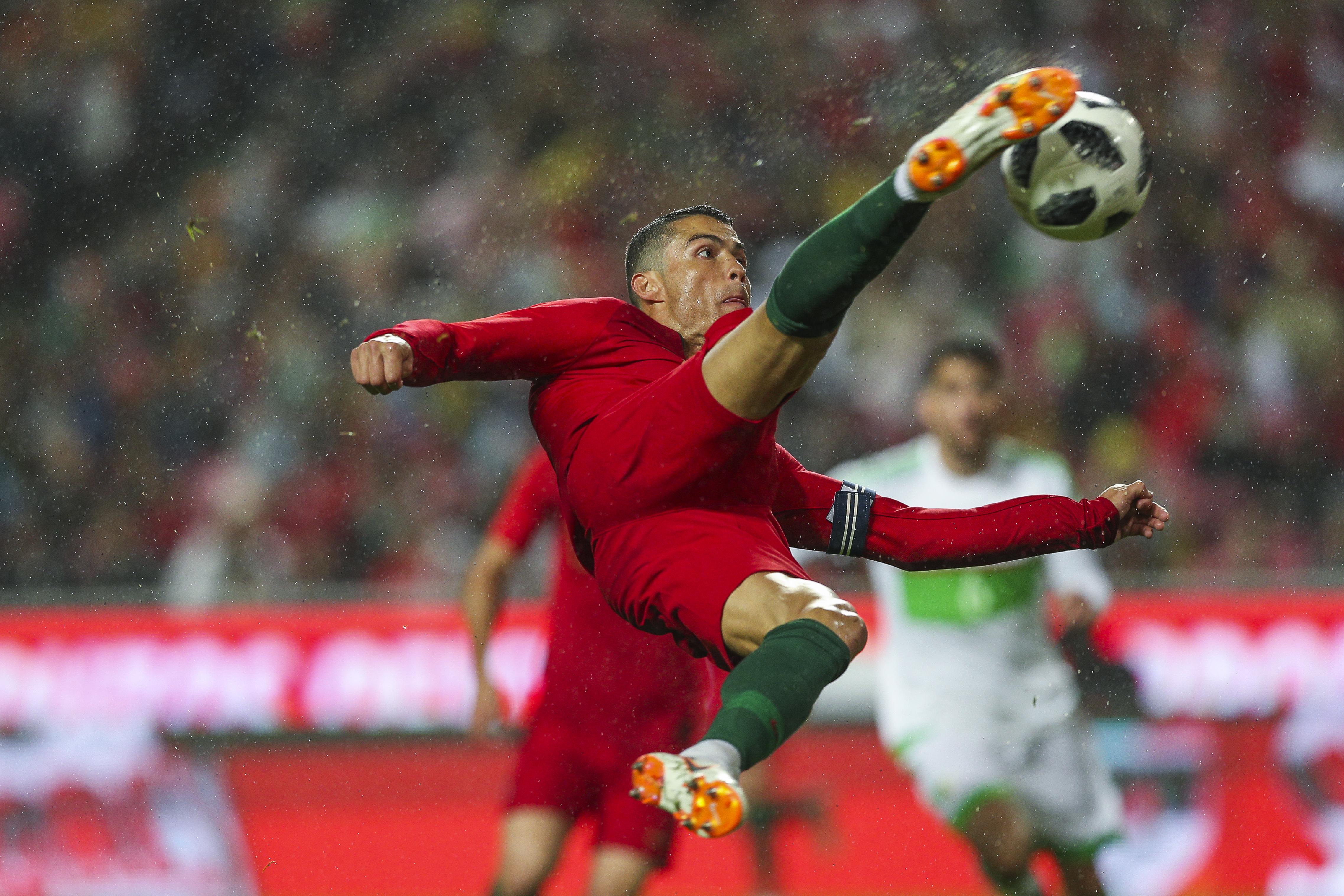 Cristiano Ronaldo kicking soccer ball