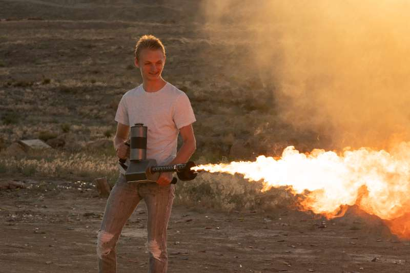 Young Man Operating a Flamethrower