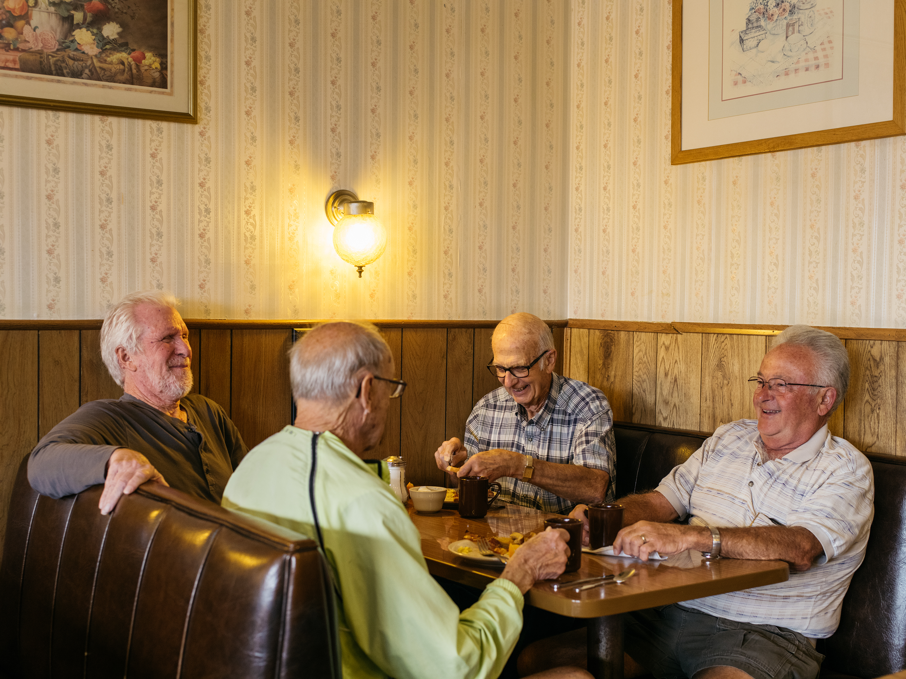 Wilbur Repp (third from left) having coffee with his daily breakfast group, Richard Ellsworth, Jack LeWarn and Ron Roberts, at Mary's Fine Foods in Kent, WA.