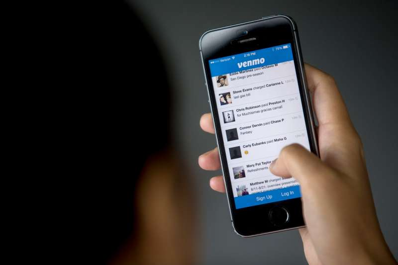 The Venmo app is shown on an  iPhone 5s