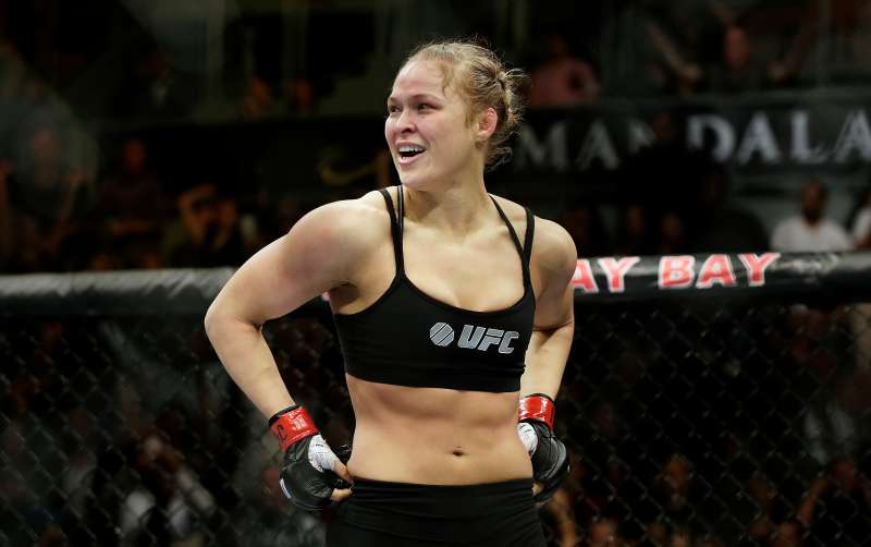 Ronda Rousey with her hands on her hips in boxing ring
