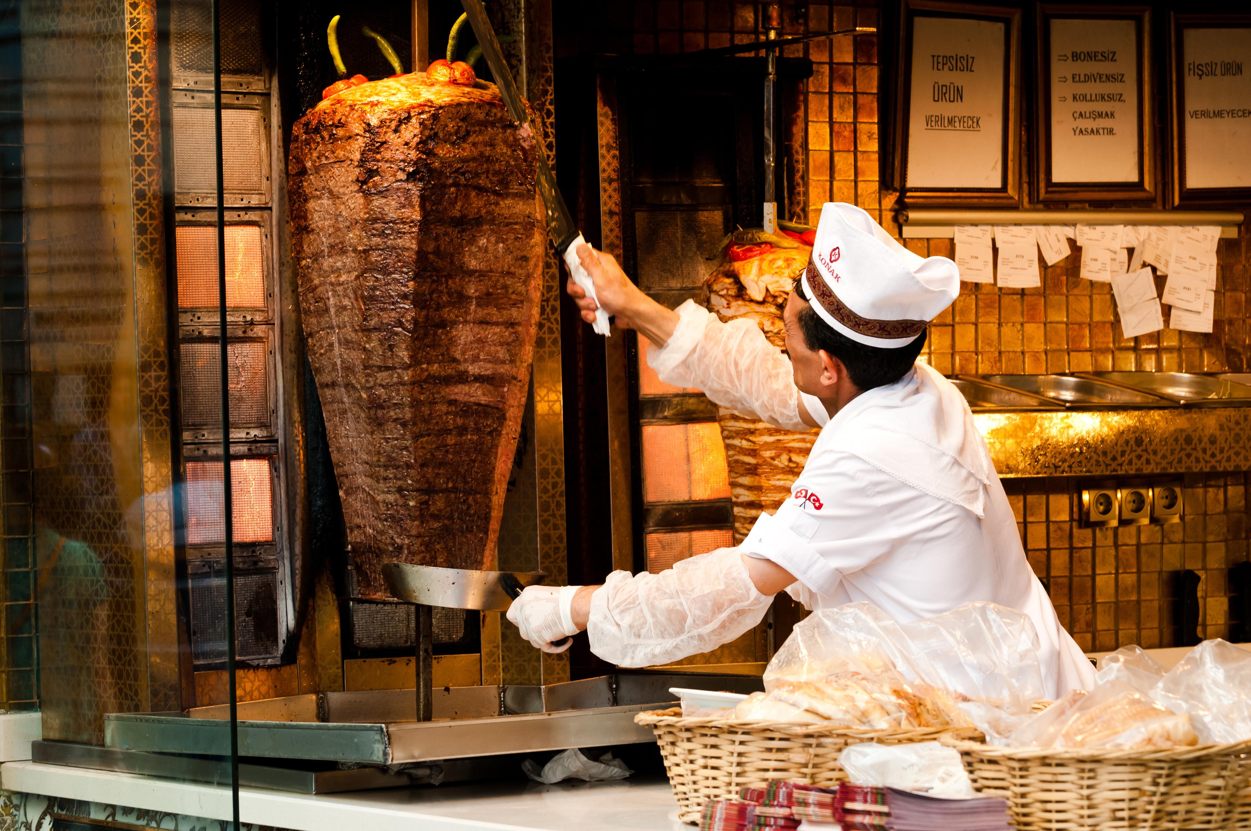 Man preparing kebab on the Istiklal Avenue, Istanbul, Turkey