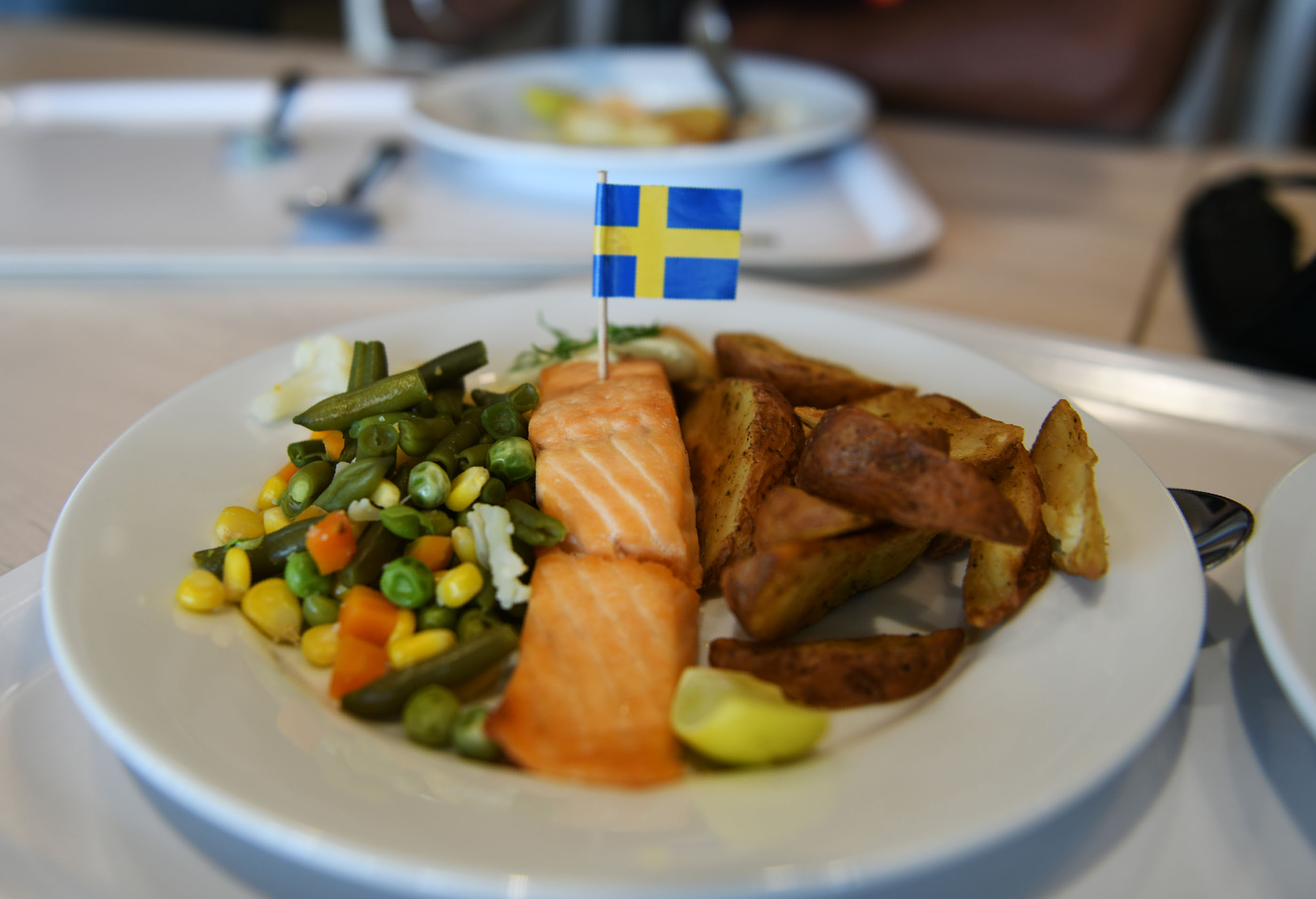 The Swedish national flag is seem placed on a plate of food at the restaurant section the new IKEA store in Hyderabad on August 8, 2018.