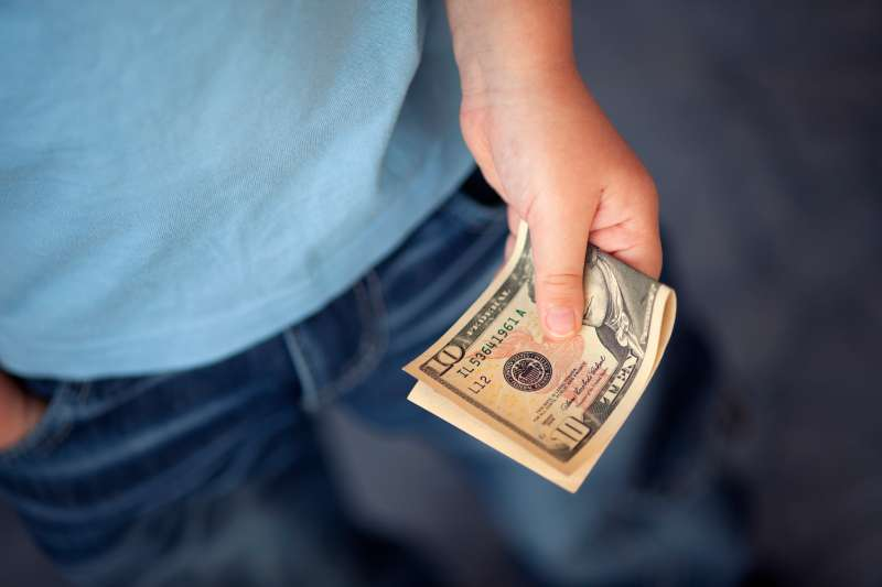 Young boy holds money