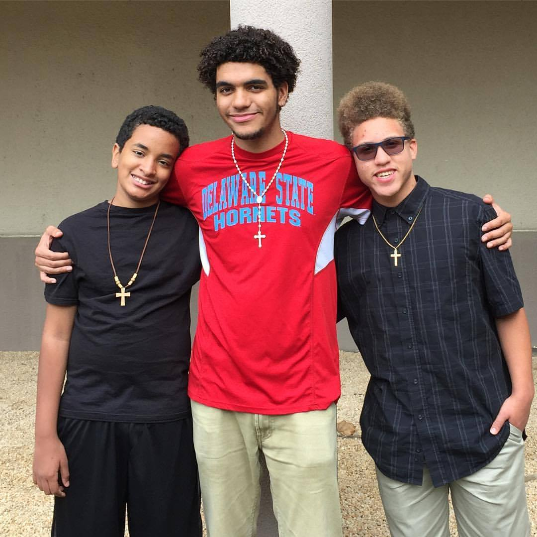 Daniel Malone Jr., center, is in his second year at Delaware State University. His brother Nick, right, will be applying to colleges this year.