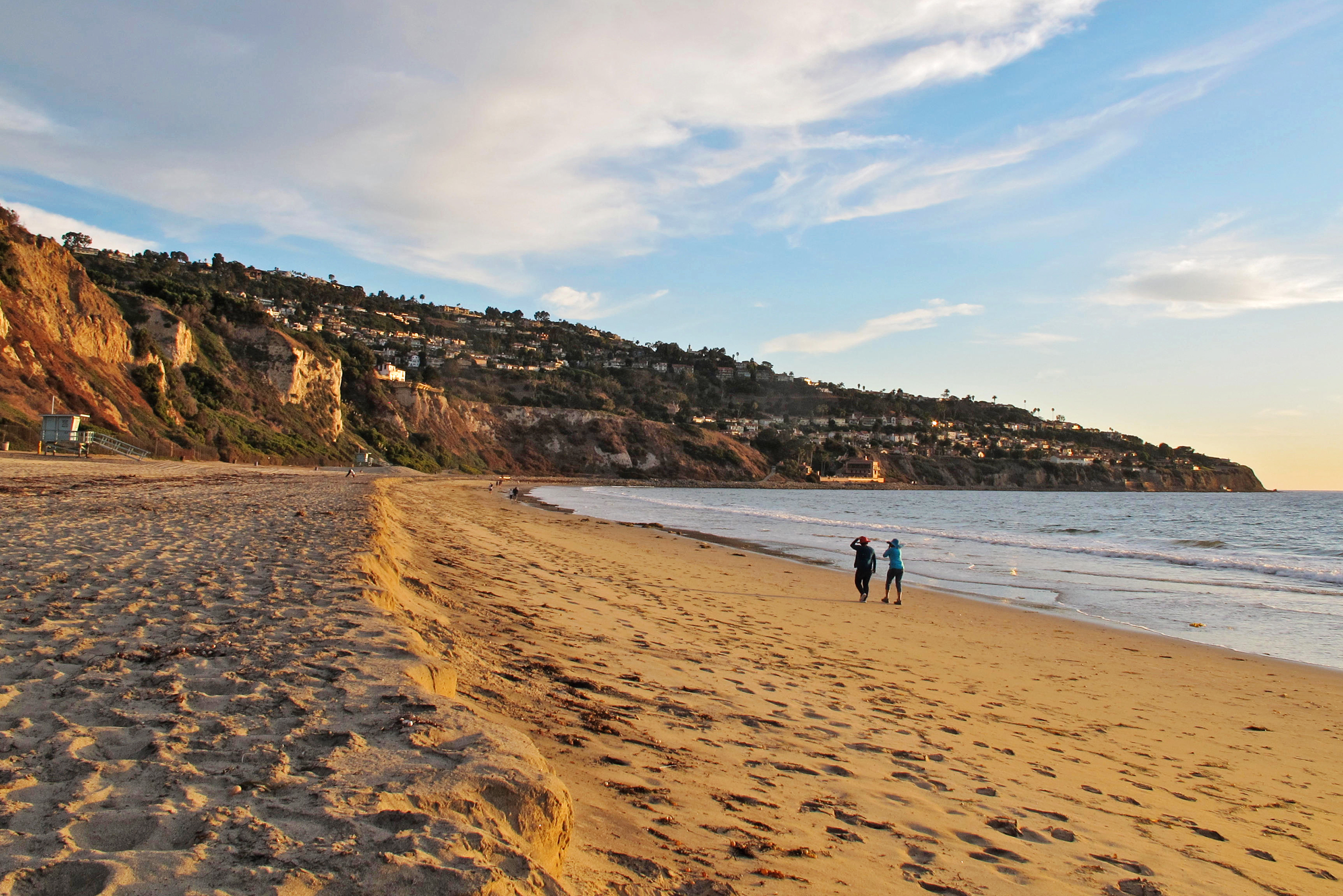 Pair Walking along the shore at Torrance Beach, Los Angeles, California