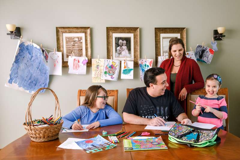 Michael Essany with wife Crista and their daughters Gianna (left) and Isabella at home in Valparaiso, Ind.