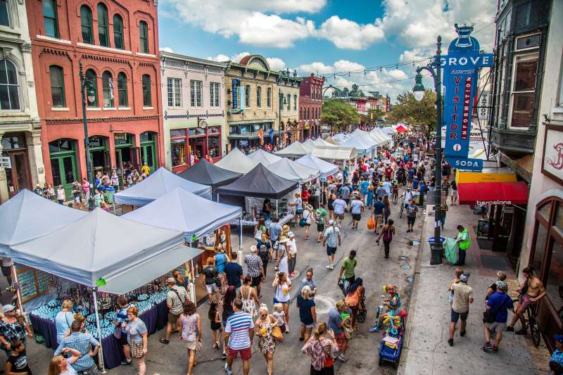 Visitors enjoy Austin's annual Pecan Street Festival, featuring arts, crafts, and music.