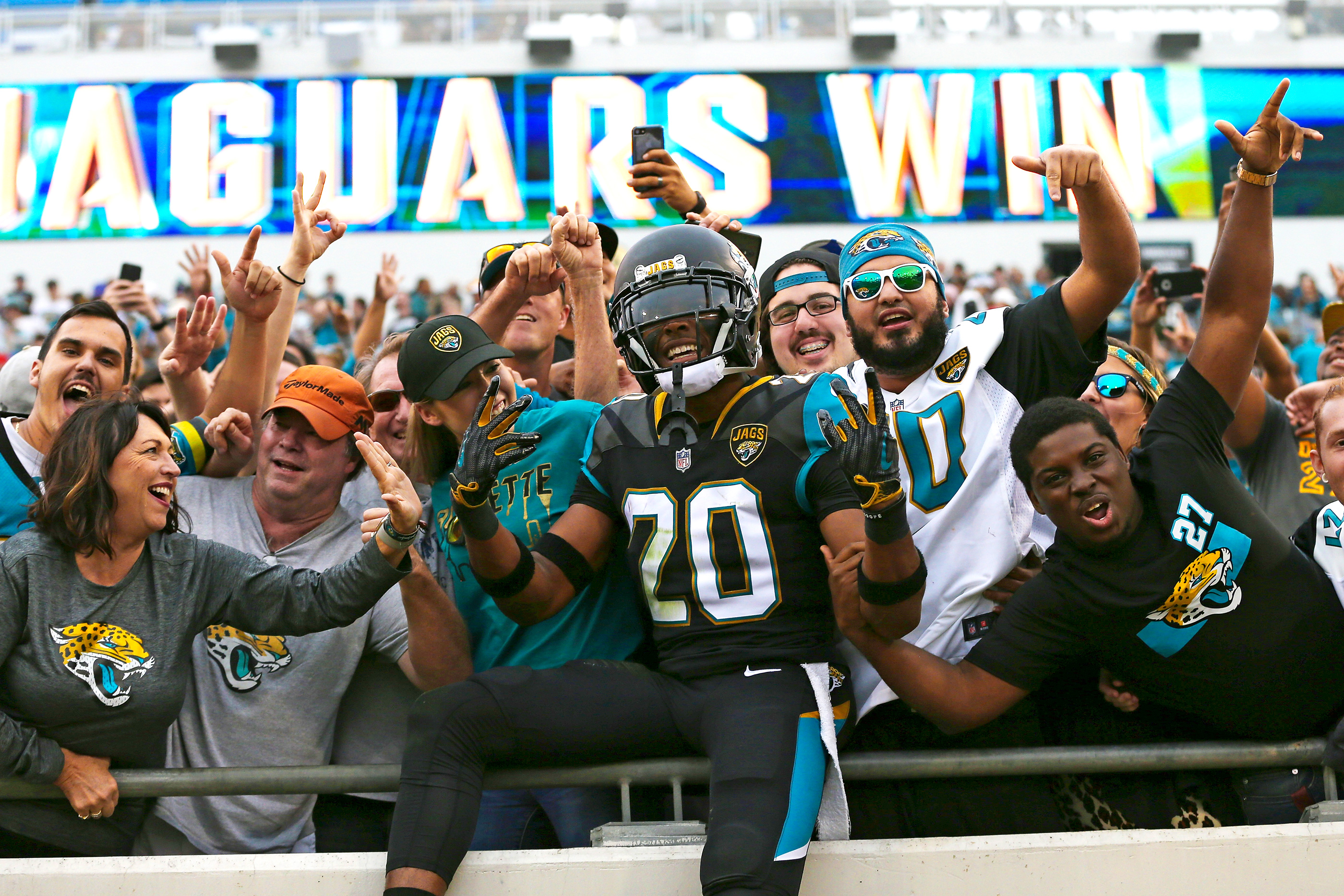 Jalen Ramsey of the Jacksonville Jaguars celebrates after a big win with fans.