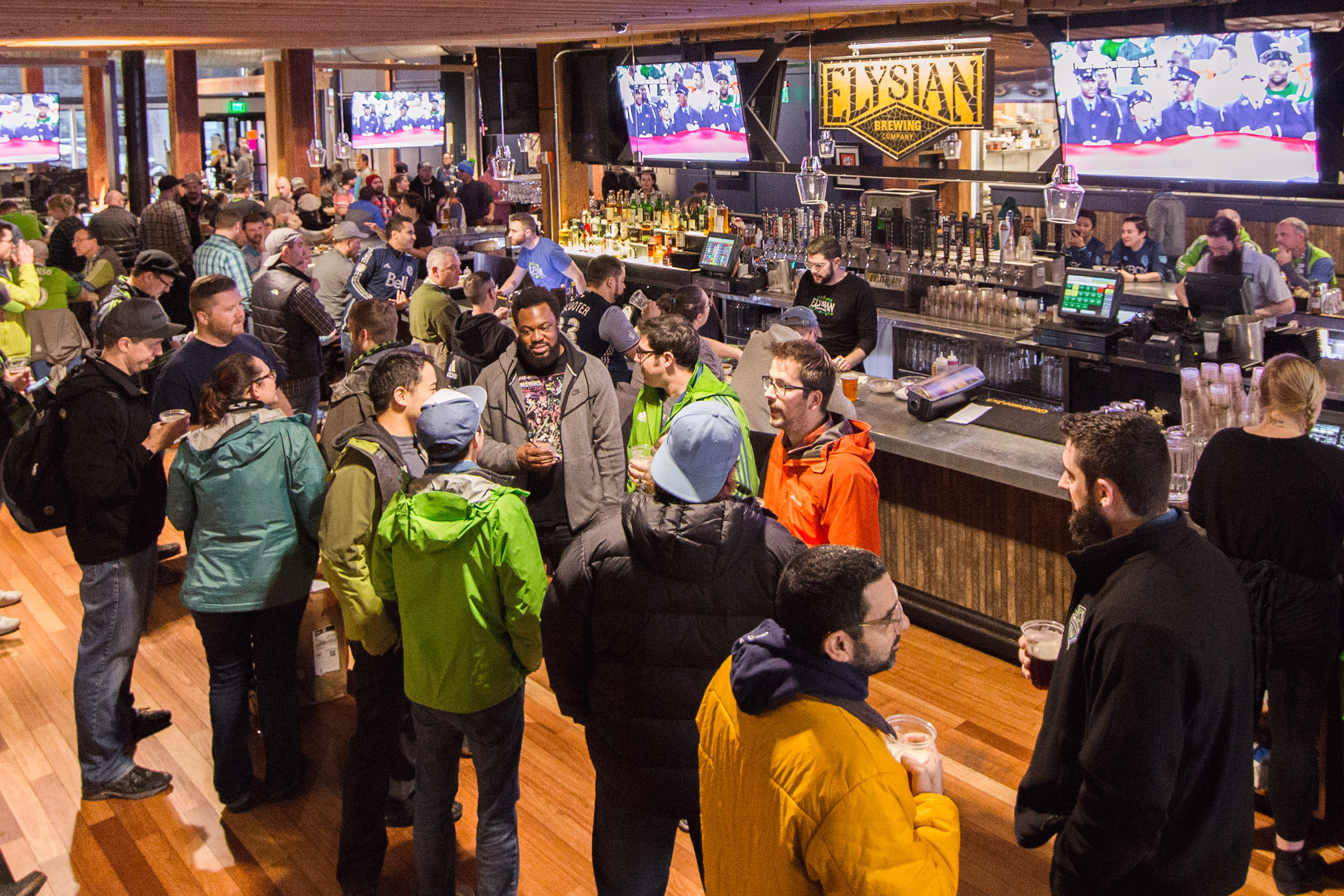 Crowds pack the Elysian Fields pub in Pioneer Square.