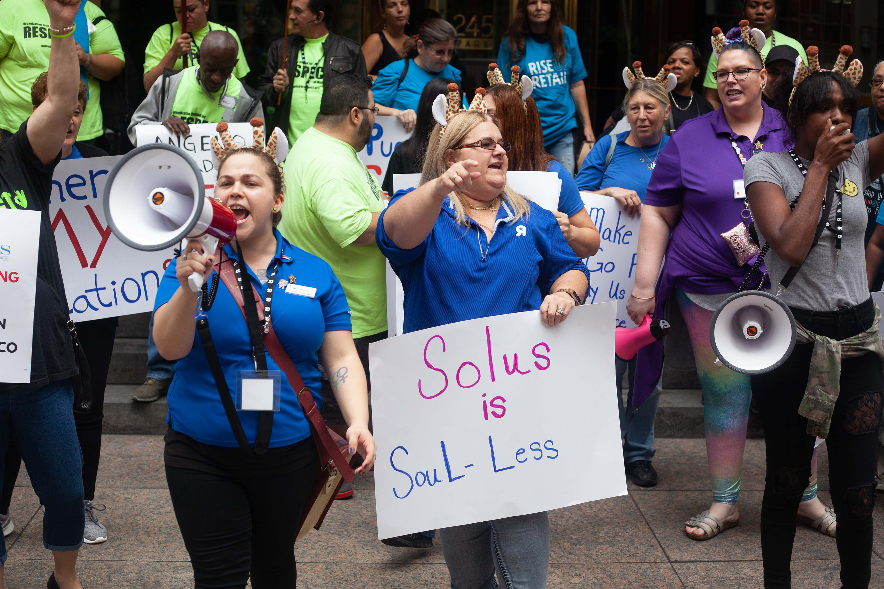 Cheryl Claude (center) and Sarah Woodhams (in purple) participate in a joint action by Organization United for Respect (OUR) Walmart leaders and Rise Up Retail leaders to protest Angelo Gordon and Solus Alternative Asset Management on Oct. 9, 2018, in NYC.
