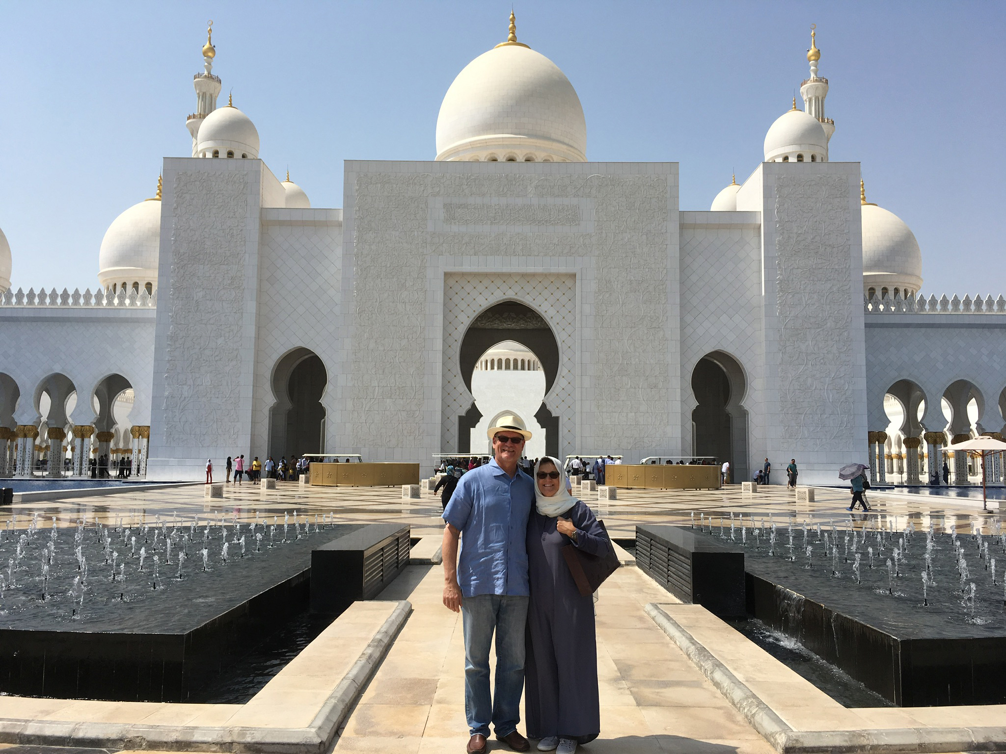 Dona Dower and her husband in front of The Grand Mosque in Abu Dhabi