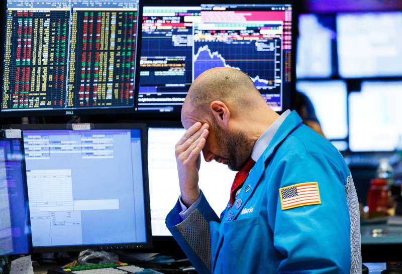 A trader works on the floor of the New York Stock Exchange at the closing bell in New York, New York, USA, on 04 December 2018.
