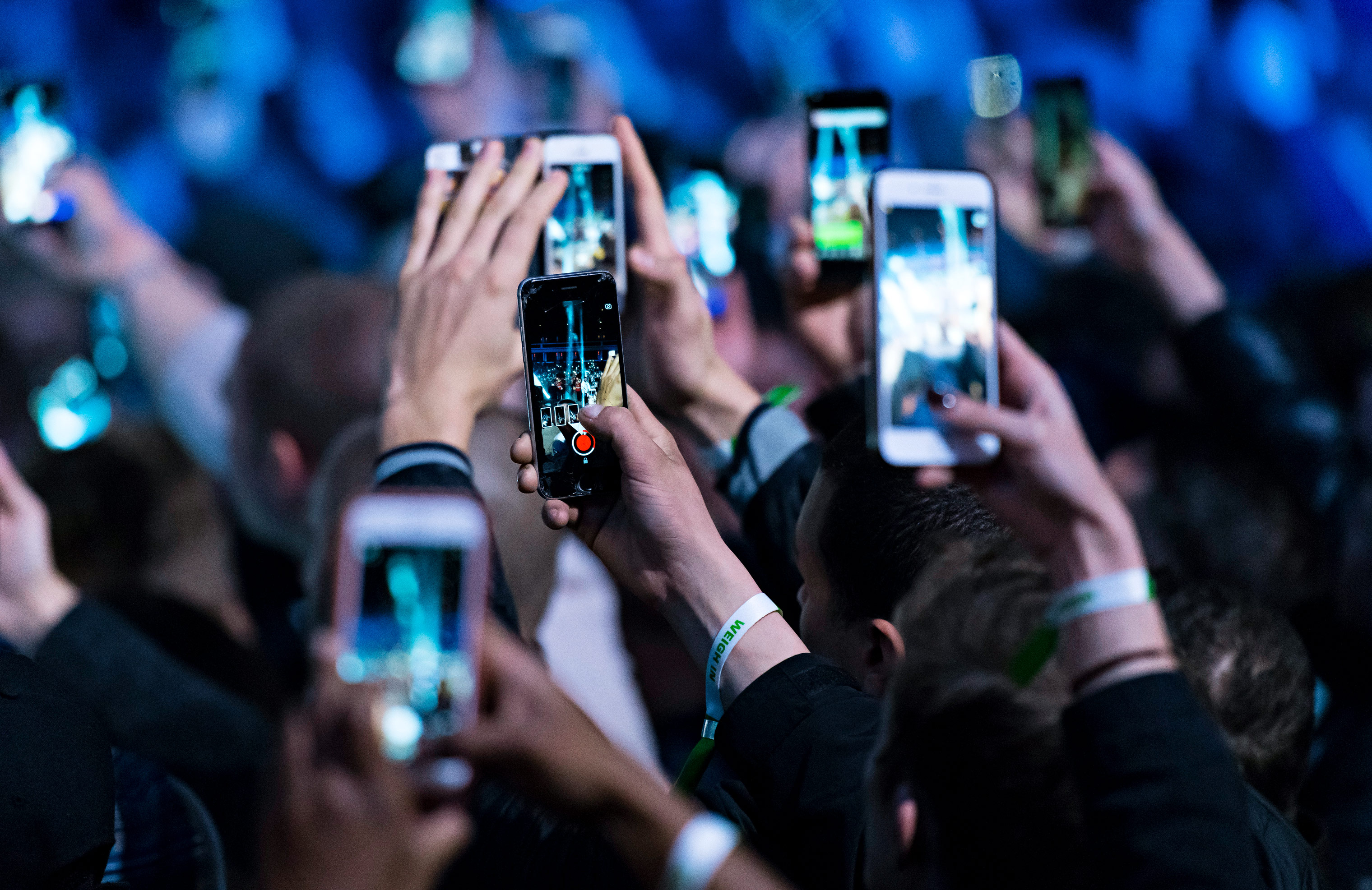 Spectators use their Apple iPhones at an event in Cardiff, United Kingdom.