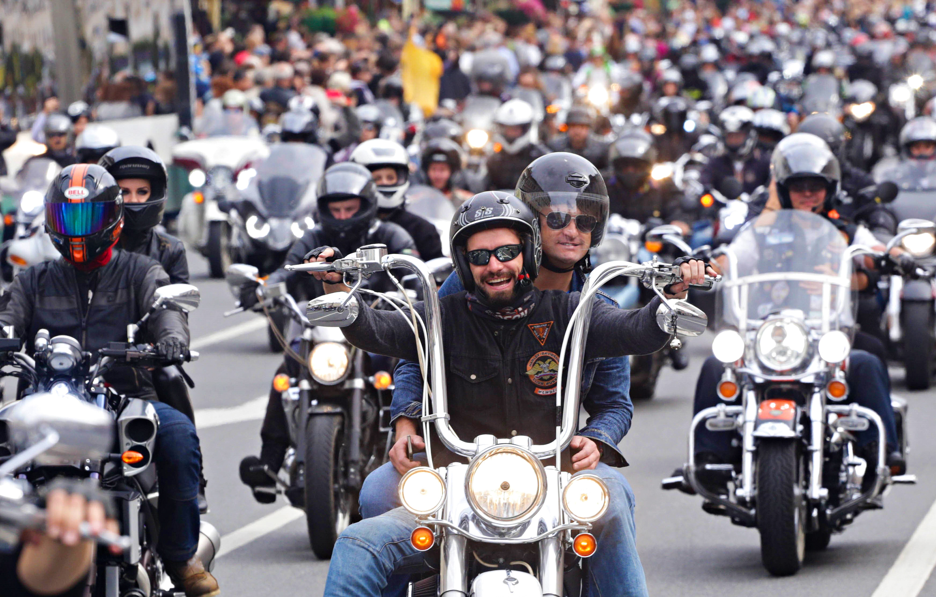 """Thousands of bikers ride their Harley Davidson motorcycles on the streets of the city to mark """"Harley Days"""" bike festival in Saint-Petersburg, Russia on August 13, 2016."""