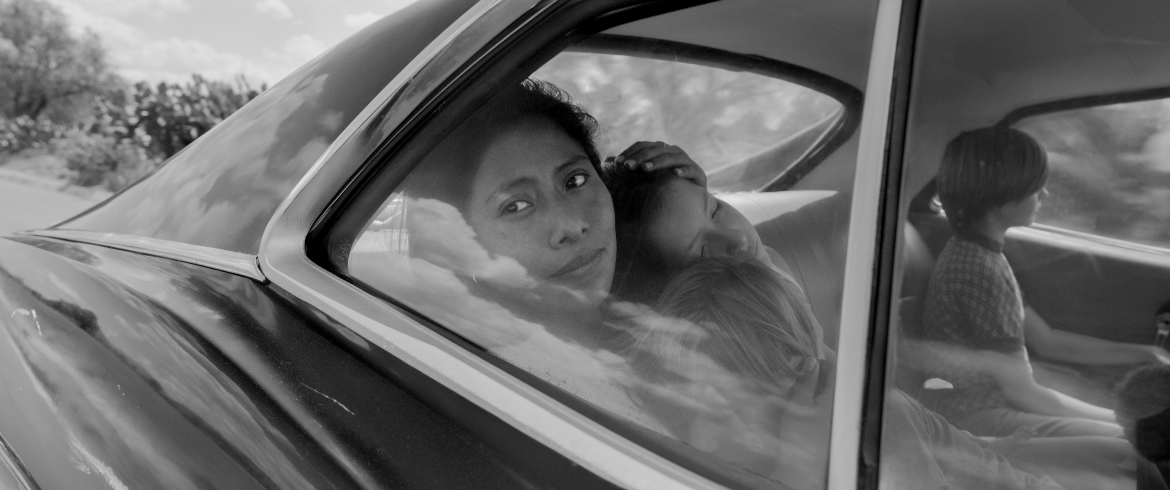 Yalitza Aparicio as Cleo, Marco Graf as Pepe, Carlos Peralta Jacobson as Paco, and Daniela Demesa as Sofi in Roma, written and directed by Alfonso Cuarón.