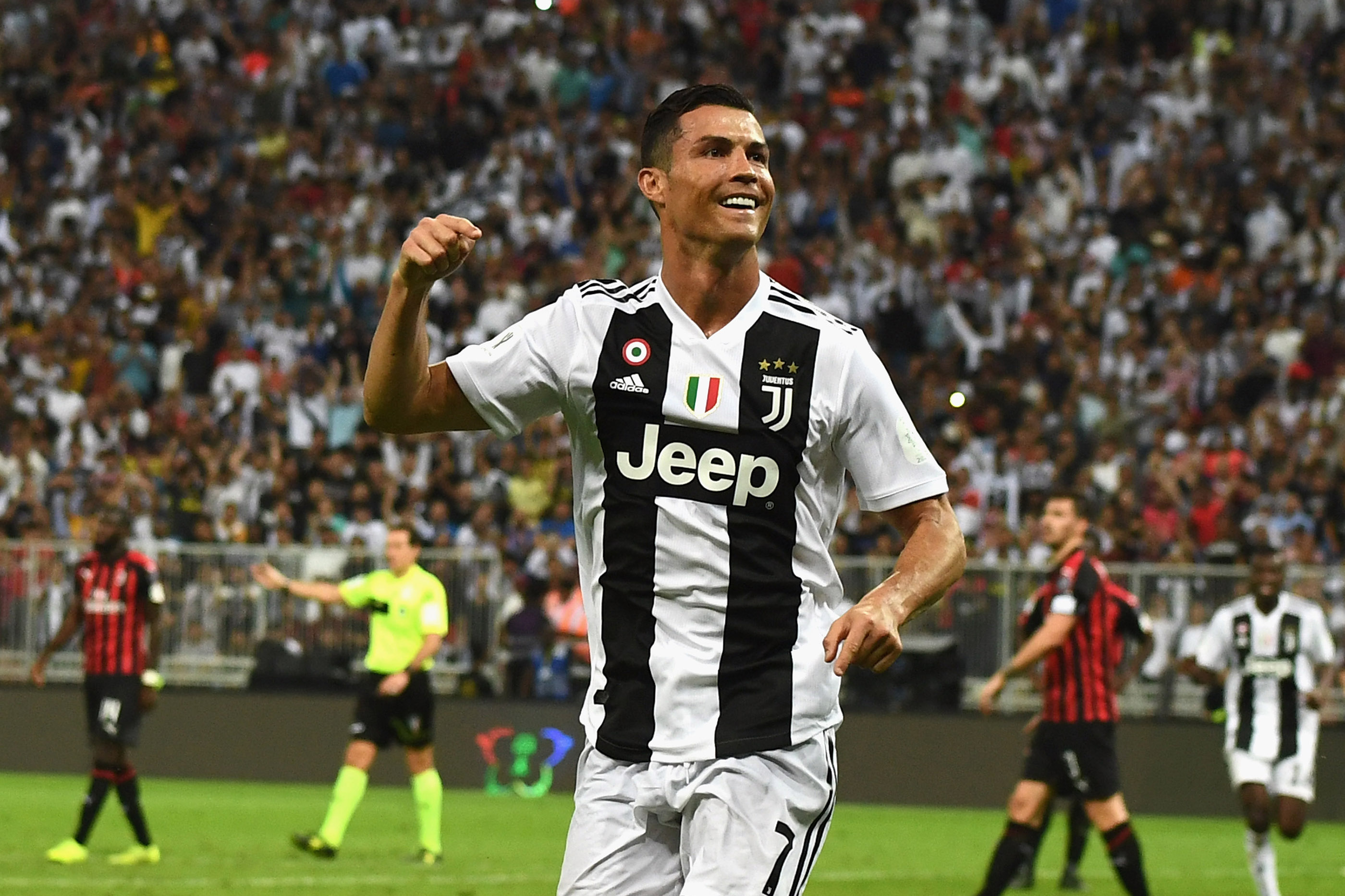 Cristiano Ronaldo of Juventus celebrates after scoring his sides first goal during the Italian Supercup match between Juventus and AC Milan at King Abdullah Sports City on January 16, 2019 in Jeddah, Saudi Arabia.