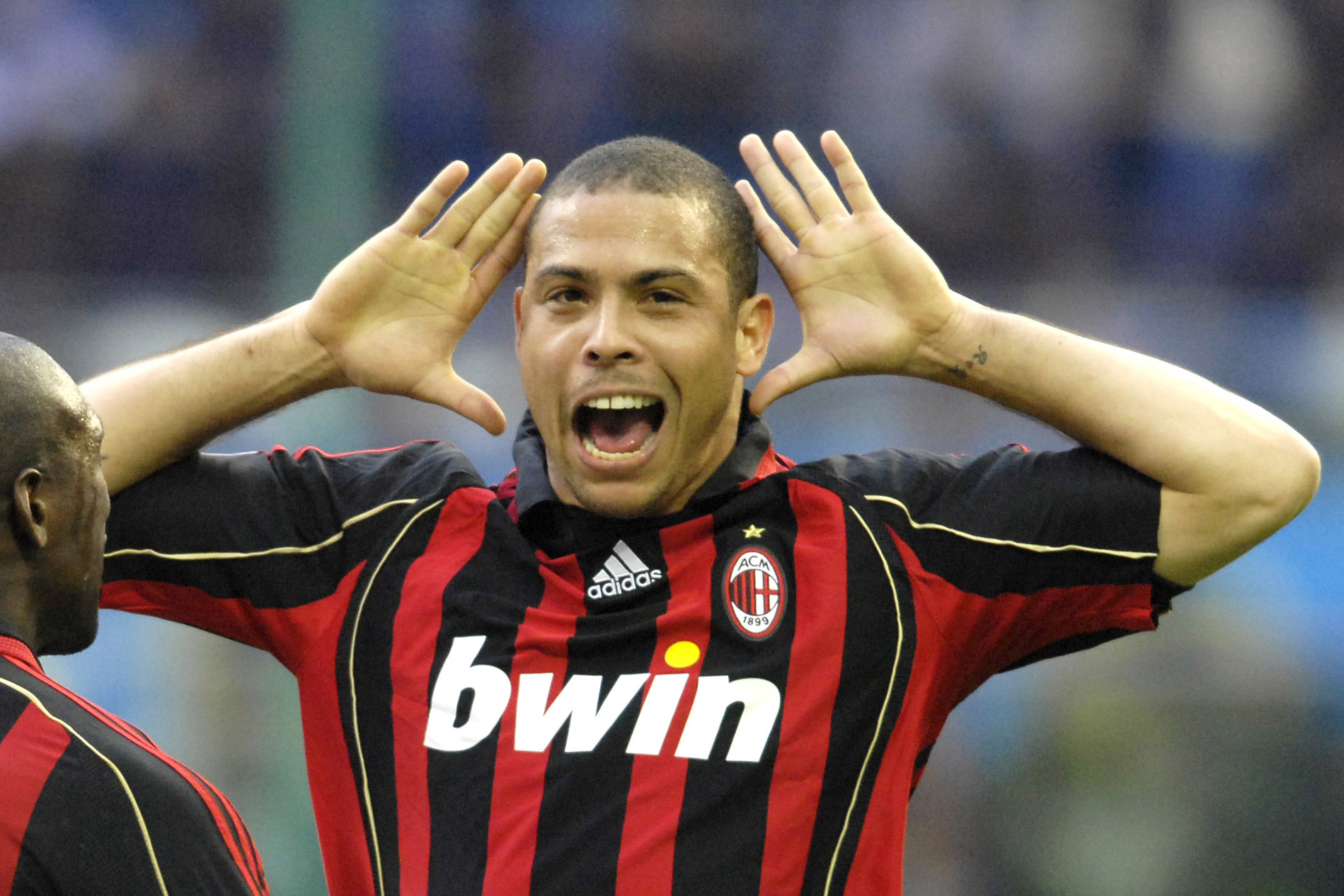 """Ronaldo of AC Milan celebrates during the Serie A 2006/2007 28th round match between Inter of Milan and Milan played at the """"Giuseppe Meazza"""" in Milan."""