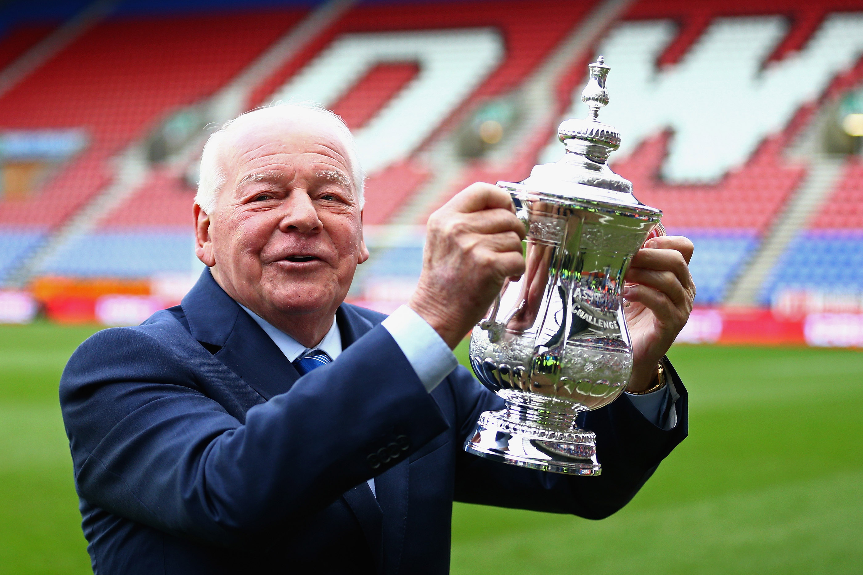 Wigan Athletic Chairman Dave Whelan holds the FA Cup prior to the Budweiser FA Cup fourth round match between Wigan Athletic and Crystal Palace at DW Stadium on January 25, 2014 in Wigan, England.