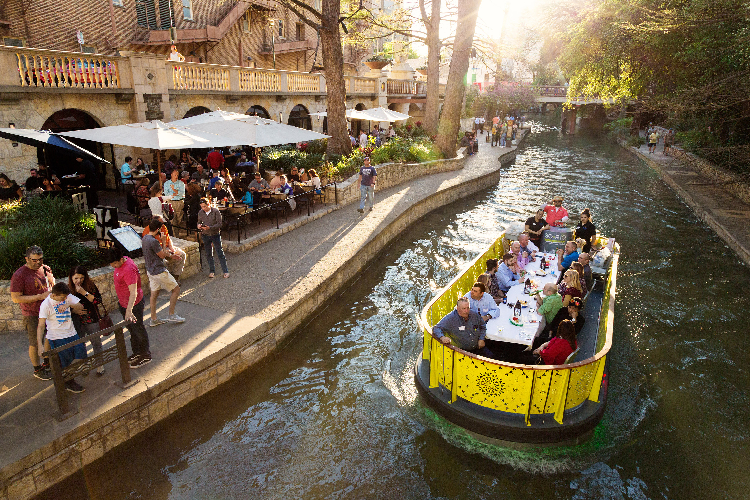 Travelers can dine on a barge and enjoy the San Antonio River Walk