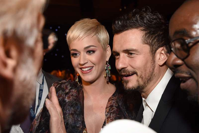 Katy Perry (L)  and Orlando Bloom attend MusiCares Person of the Year honoring Dolly Parton at Los Angeles Convention Center on February 8, 2019 in Los Angeles, California.