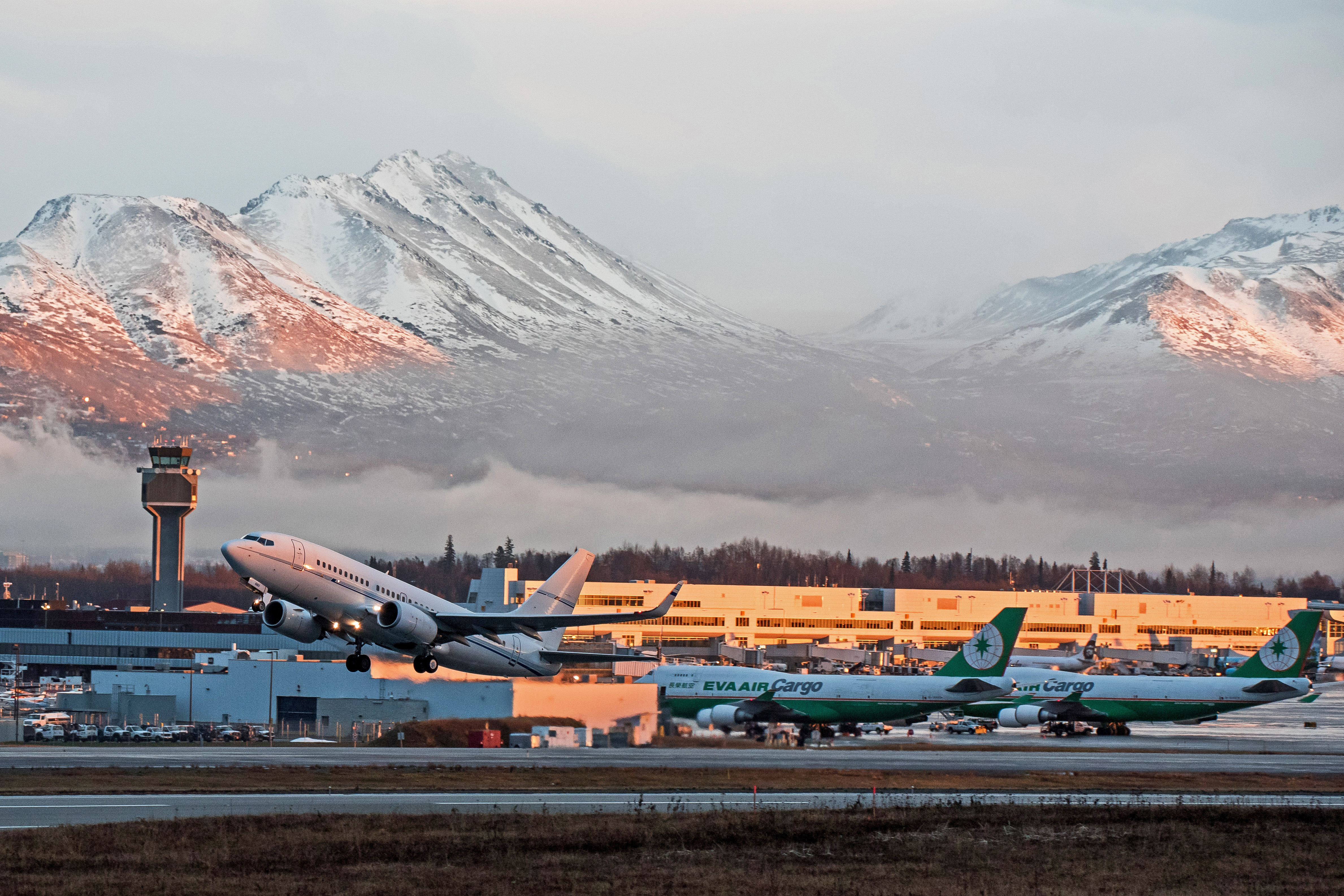 Aircrafts depart from Ted Stevens Anchorage International Airport at sunset, Anchorage, Alaska