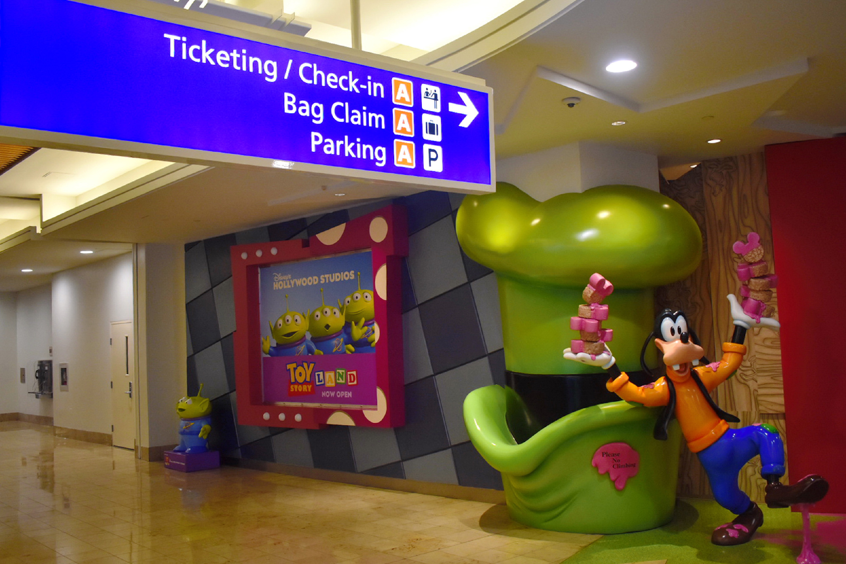 Orlando, Florida; August 28, 2018: Ticketing and Check in information sign at the airport and Goofy.