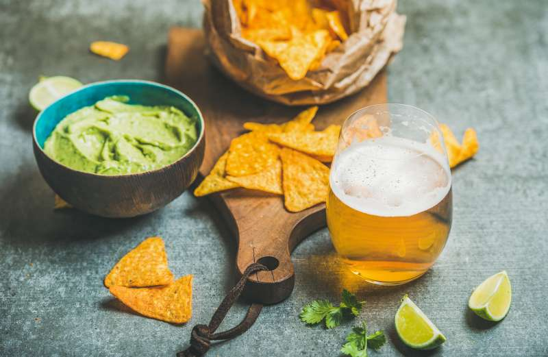 Mexican corn chips, fresh lime, guacamole sauce and wheat beer
