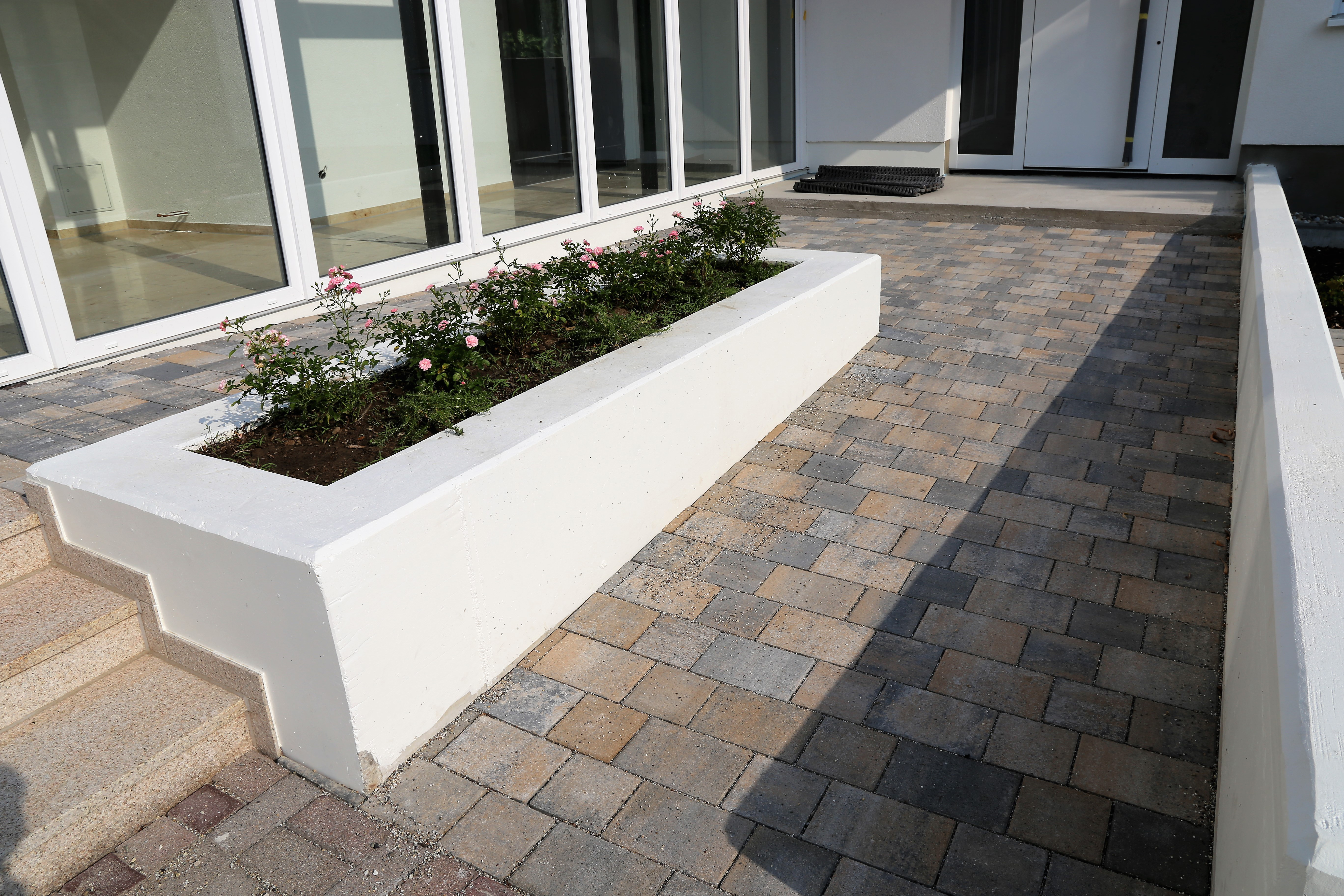Modern paved building access with barrier-free wheelchair ramp