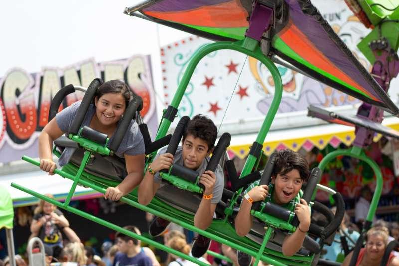 Children on a fair ride in Shawnee, Kansas