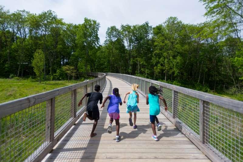 children running on a bridge in Fishers, Indiana