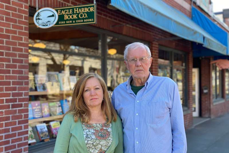 Jane Danielson and Dave Danielson in front of their bookstore, March 16, 2020.