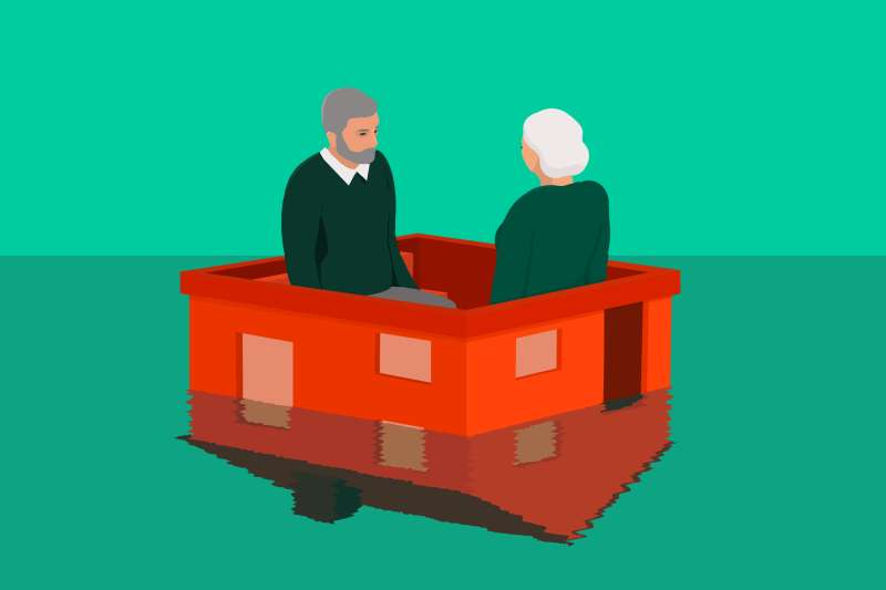 two older adults sitting on a house that is going underwater what is a reverse mortgage