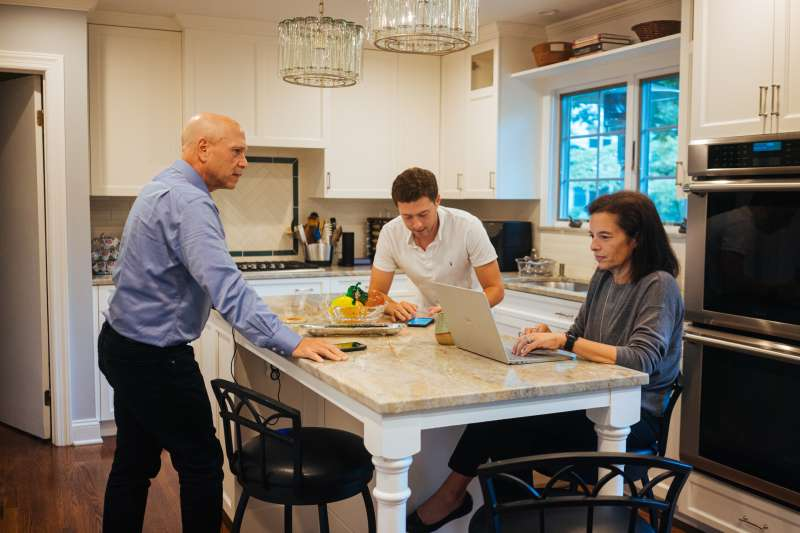 Lynn Pollack with her son and husband in their kitchen, September 2, 2020.