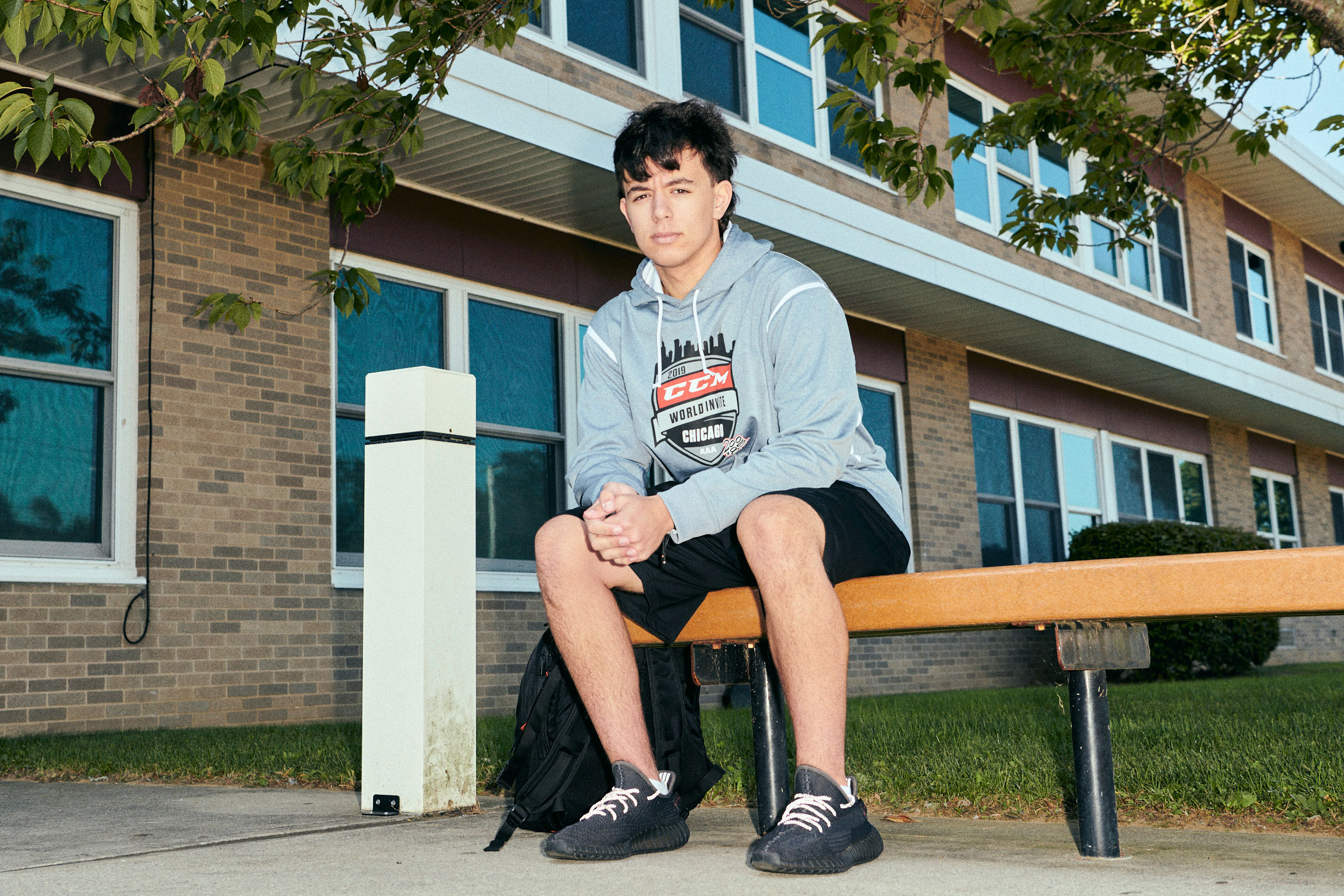 Zach Sprung sitting in front of his high school
