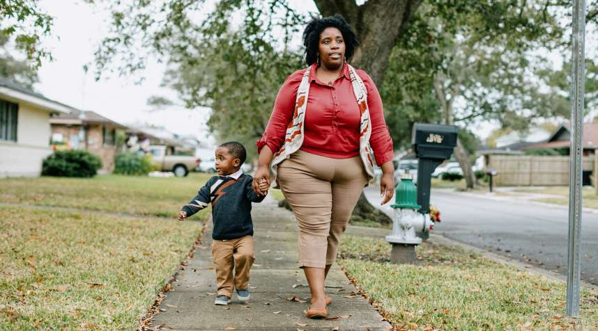 Dasja Reed takes a walk with her with her 2-year-old son, Jarret