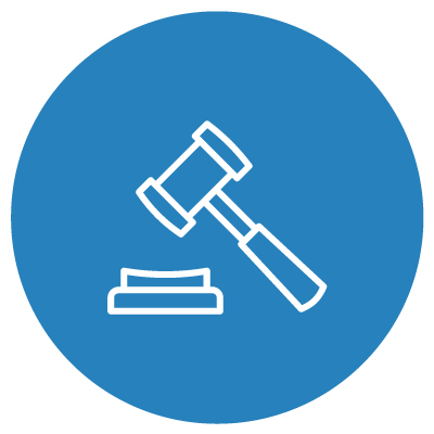 White gavel and block on blue background