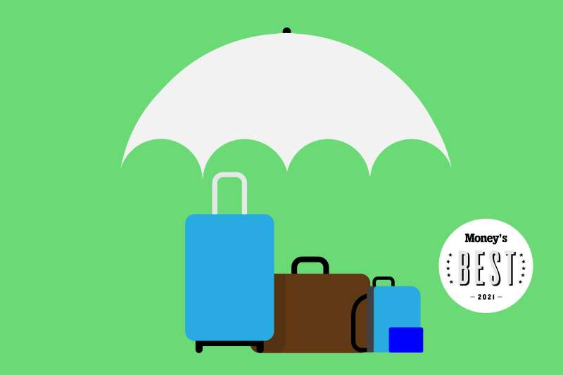 Three suitcases under a large umbrella