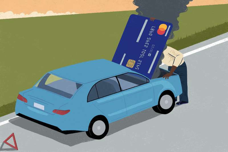 A man is looking into under a car with credit card hood