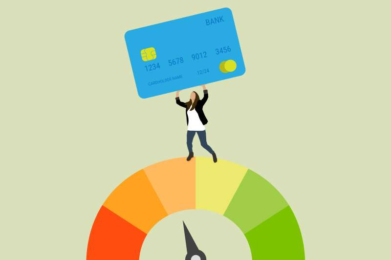 A woman lifting a credit card standing on top of the credit score wheel.