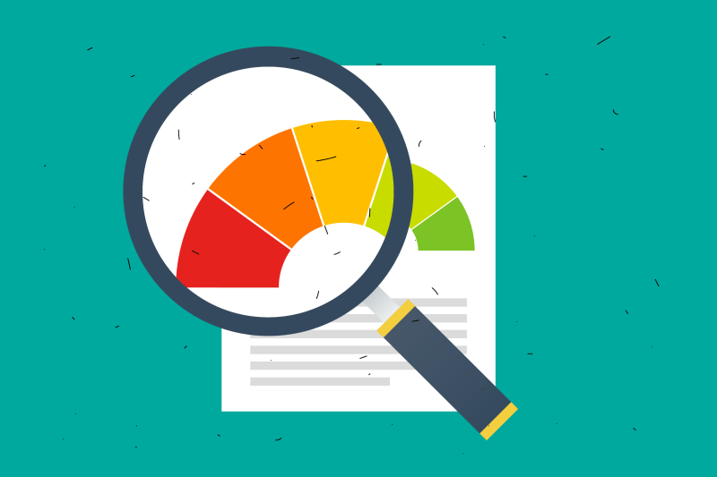 Magnifying glass over a paper with credit report wheel.