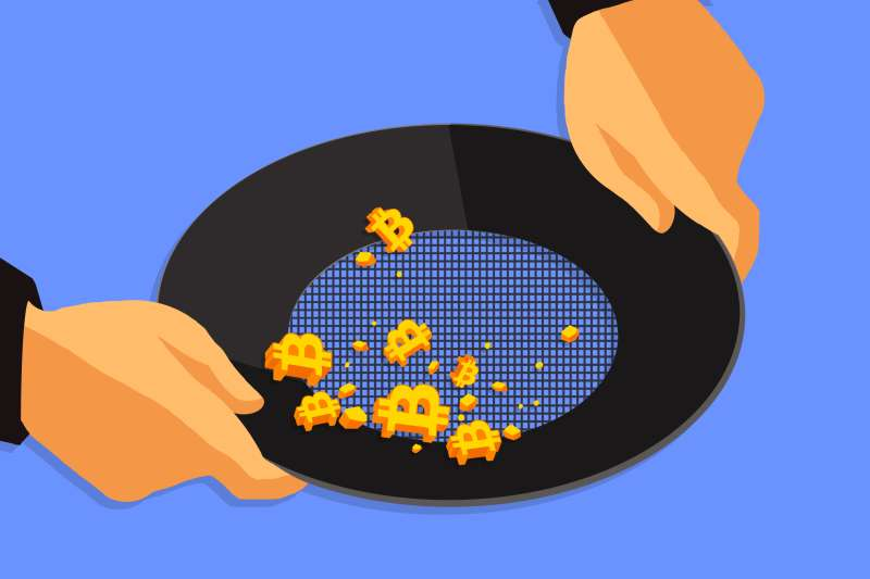 Two hands washing gold bitcoin in a pan